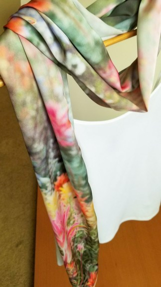 wildflowers scarf wrapped around neck on white tank top