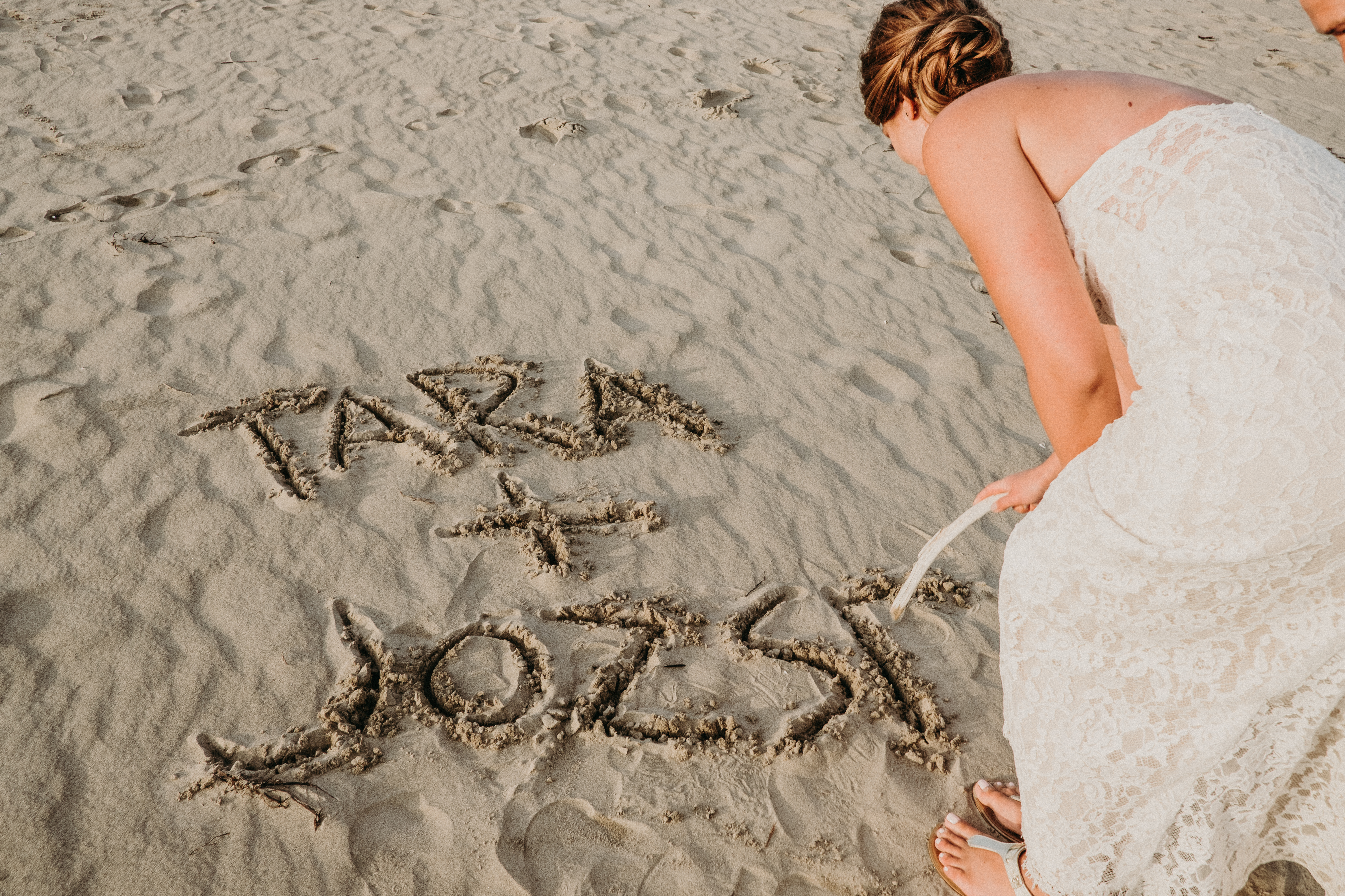 sauble beach backyard wedding ceremony bride and groom vows just married ontario sand writing in sand