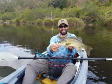 Danny with a solid Bass he caught from his Mailbu Kayak on the Clarence River