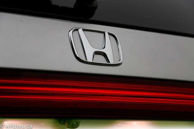 Honda badge and camera