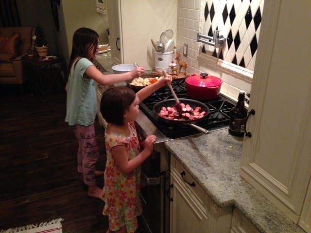 both girls cooking