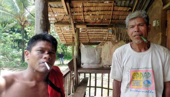 Relaxing after building dugout canoes, Siargao Island; tobacco vs. ciggs