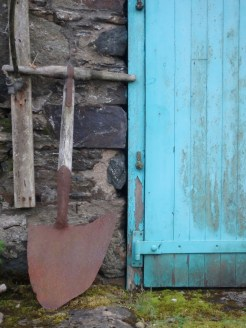 Blue door with ditching spade