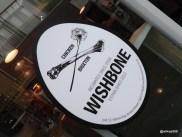 Wishbone Brixton - Chicken Bone and Dandelion Logo