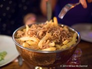 """Epic Beef Dripping Fries, topped with crispy shallots served with jugs of gravy"""