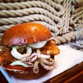 Fish fillet burgers served with Channel squid rings and jalapeño mayonnaise