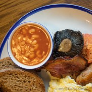 "The Fisherman's Breakfast (""Streaky bacon, Cumberland Sausage, eggs, field mushrooms, grilled tomato, baked beans, French toast with a offer of your choice"")"