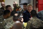 Trump makes an unannounced Thanksgiving visit to US troops in Afghanistan and serves up turkey dinners on his first trip to the country before announcing the resumption of talks with the Taliban