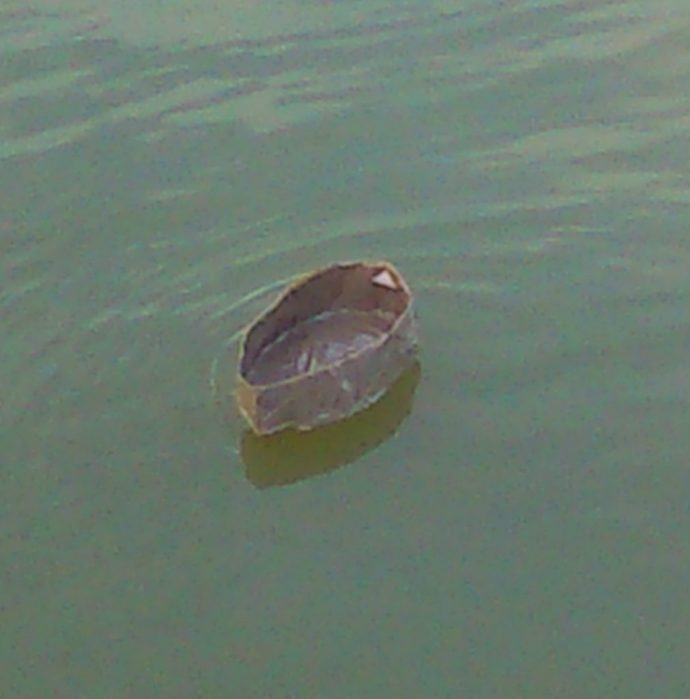 Parcel tape boat on the water 1