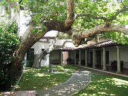 A view of the tree-filled court yard of Balch Hall  at Scripps College