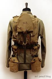 """Field Marching Pack: M1941 Haversack, M1941 Suspenders, shelter half, e-tool. An """"upgraded"""" Marching Pack designed for field marches that included bivouac."""