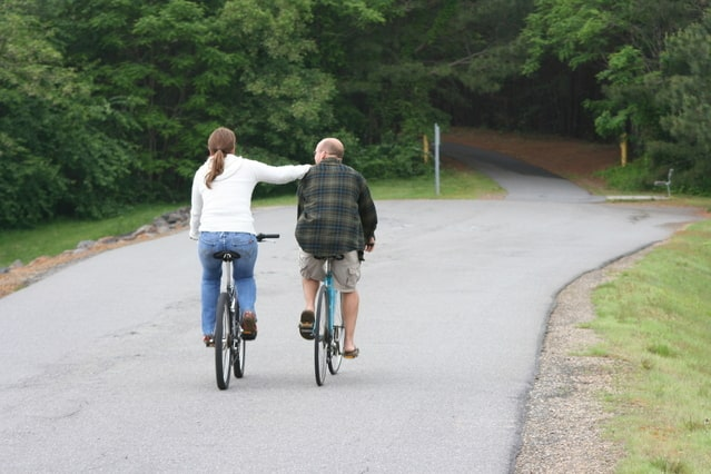 Image of two bicyclists for an article about long-distance caregiving.