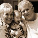 Image of grandparents and a grandchild for an article about how to make multi-generational living work.