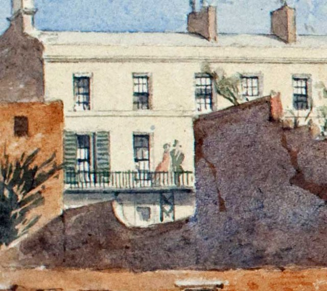 A couple overlook their rear garden from one of Williamson's Mason Street houses