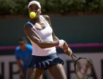 Venus Williams of the United States returns a shot during the women's singles tennis match against Paula Ormaechea of Argentina, at the Fed Cup World Group II first Round in Buenos Aires, Argentina, Saturday, Feb. 7, 2015. (AP Photo/Rodrigo Abd)