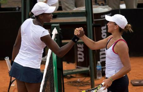 Venus Williams of the United States shakes hands with Maria Irigoyen of Argentina after winning their Fed Cup World Group II first round women's singles tennis match, in Buenos Aires, Argentina, Sunday, Feb. 8, 2015. Williams defeated Irigoyen 6-1, 6-4 on Sunday to advance the United States to the Fed Cup playoffs in April. (AP Photo/Rodrigo Abd)