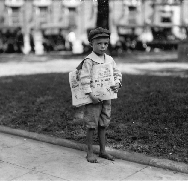 7 year old Ferris. Tiny newsie who did not know enough to make change for investigator. Mobile, Alabama, 1914 (Lewis Hine)