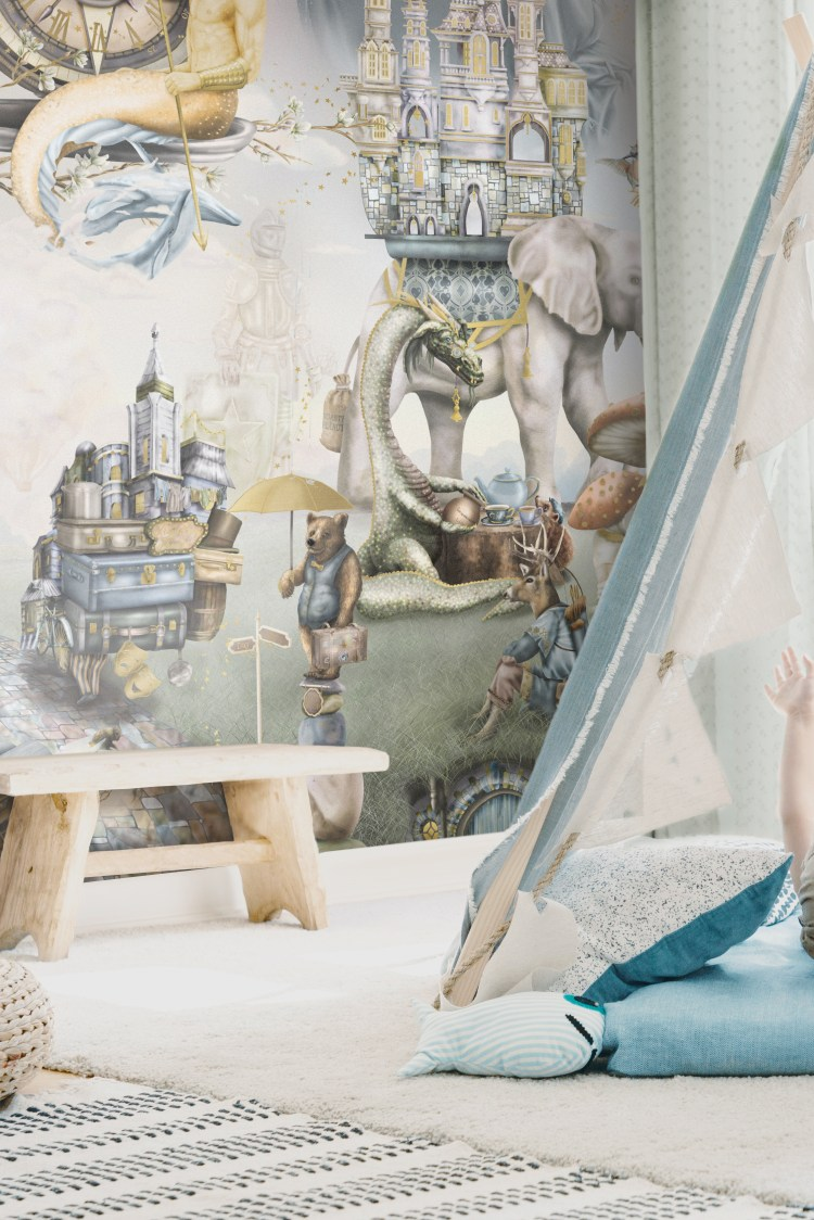 A cool woodland forest theme boys playroom with a custom wallpaper wall mural design that has foxes, dragon, bear, deer, elephants and more! In sage green, beige, brown and steel blue,
