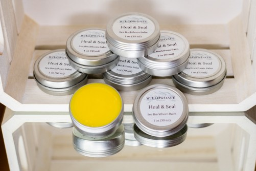 Heal and seal with a stock pile of products on shelf.