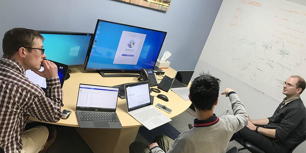 Three Willowglen employees work in an office