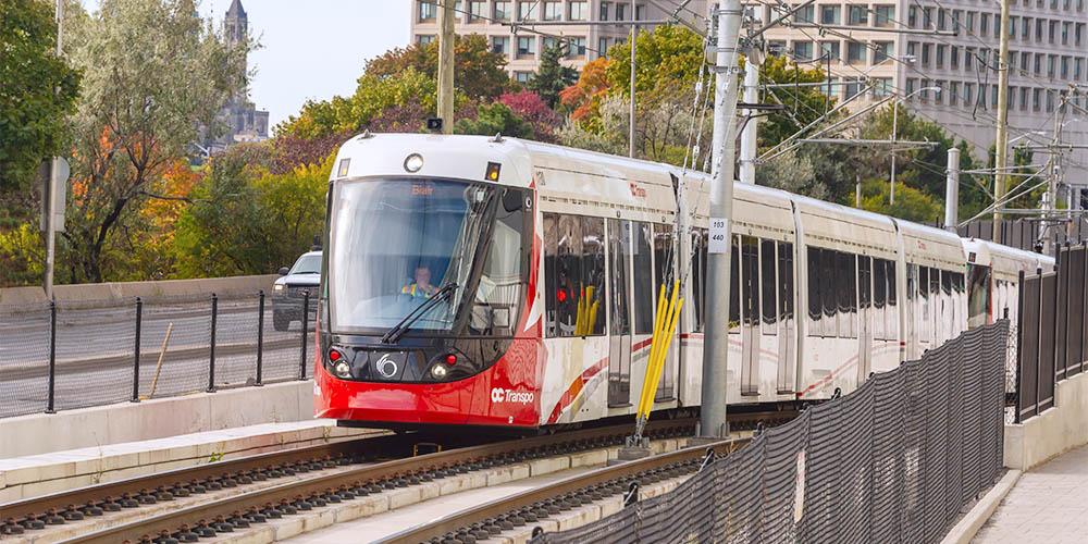 Ottawa, Canada. OC Transpo Train arriving at uOttawa Station.