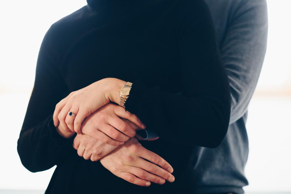 couple wrap arms together and hug