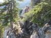 Narrow ledge around small peak