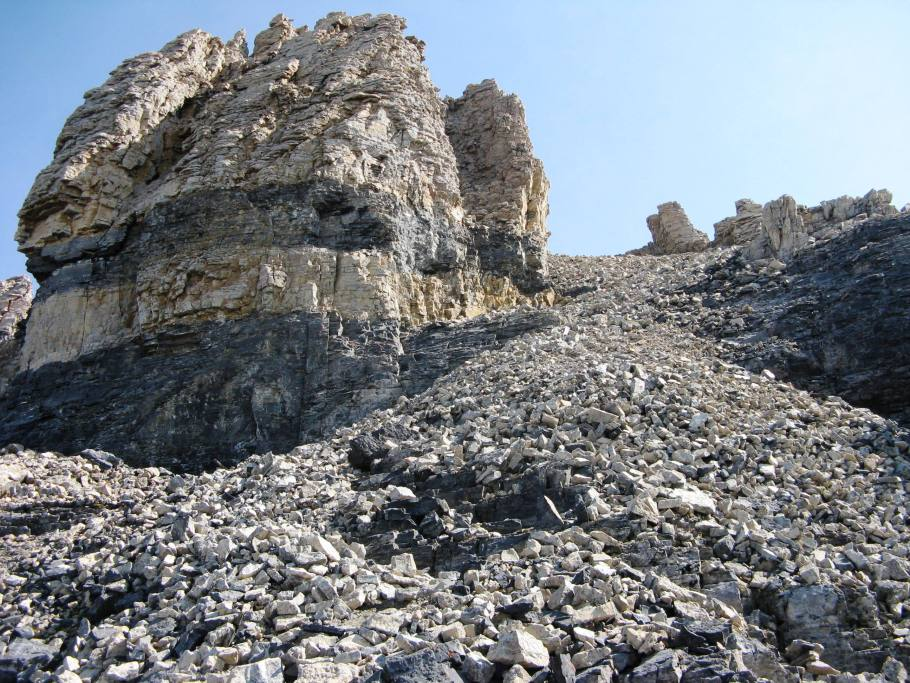 The summit is found to the left of the rock face.