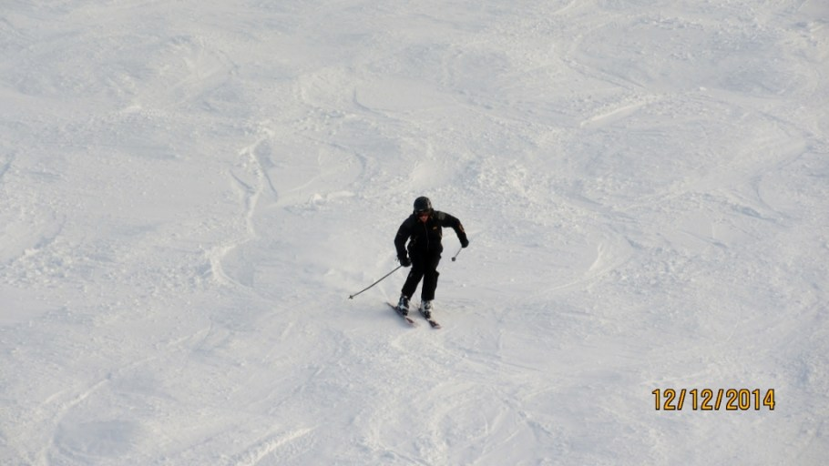 Skiing under the Divide chair on North Divide run