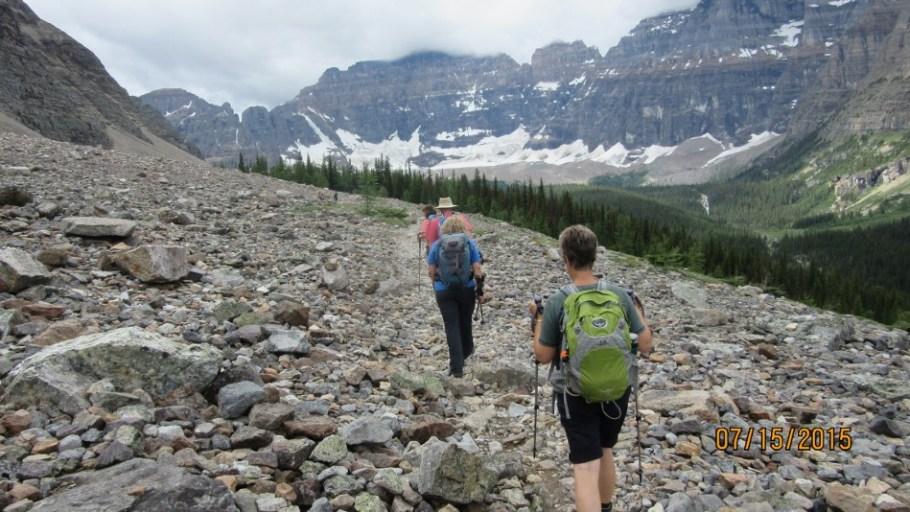 Crossing rock avalanche. Hungabee and Horseshoe Glacier