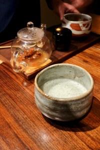 Atelier Crenn - Matcha tea service - chicken boullion, matcha, toasted rice, goji