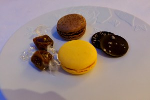 Epicure - Petit Fours selection - passionfruit milk chocolate macaron, nutella macaron, dark chocolate with coffee bits, salted caramels