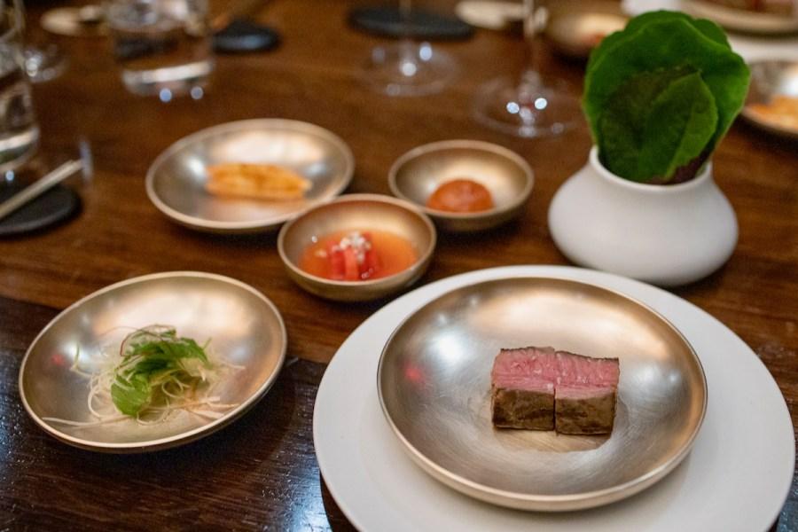 Benu - Beef rib steak, grilled tongue, braised short rib, radish and pear kimchi, kohlrabi kkakdugi, scallion salad, meju, lettuces