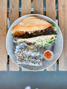 Masabaga - Saba Sandwich - Norwegian Mackerel, Frisee, Onion, Meyer Lemon, Pickled Daikon, Mustard Ranch Mayo. Black Sesame Tapioca Cracker