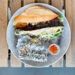 Masabaga - Saba Sandwich - Norwegian Mackerel, Frisee, Onion, Meyer Lemon, Pickled Daikon, Mustard Ranch Mayo. Black Sesame Tapioca Cracker