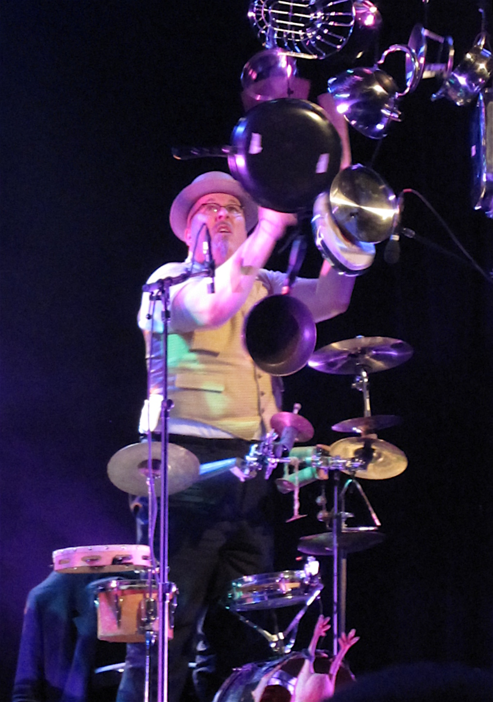 "Adrian Huge battles descending pots and pans in ""Fidgety Phil,"" a number from the band's musical Shockheaded Peter."