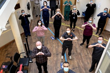 Group of people in mask posing at Wilmow Health Centre