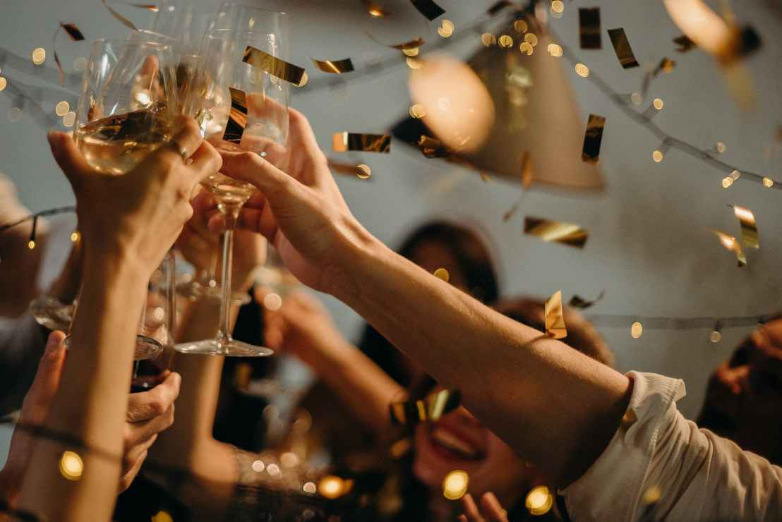 people toasting wine glasses