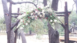 rustic floral arch cranberry white gray wilsons floral design helotes