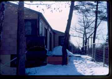 Porch, no roof, oil tanks