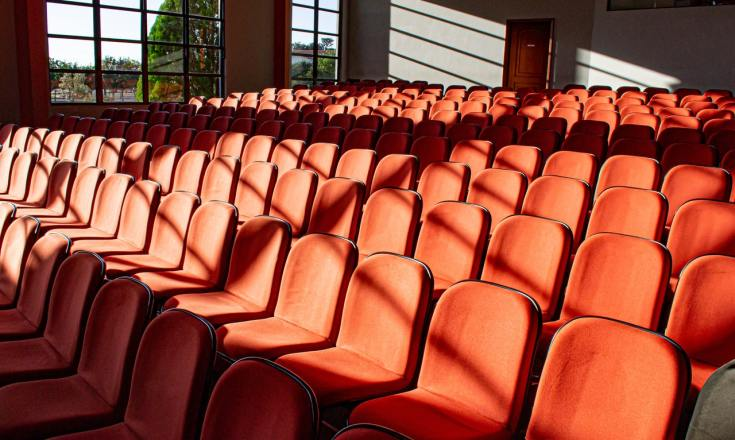 Empty seats in auditorium (courtesy Pexels.com)