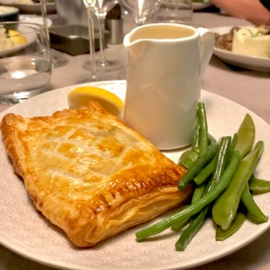 Salmon en croute with a beurre blanc and greens