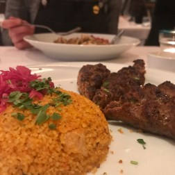 Izgara Köfte – Minced lamb, onion and green pepper patties, seasoned with parsley and herbs served with couscous.