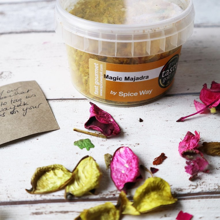 A pot of Magic Majadra with petals laying in front