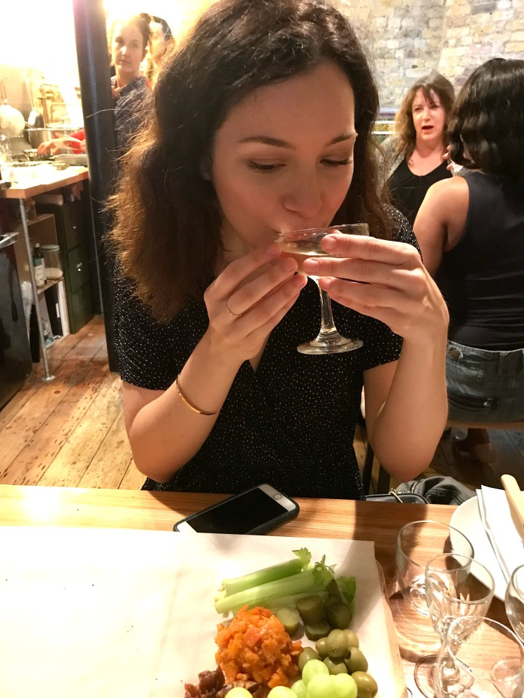 Claire tasting her sparkling wine