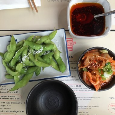Flat lay of edamme beans and kimchi
