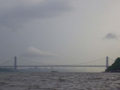 Ahead, the George Washington Bridge, and beyond it the city, reappear out of the fog