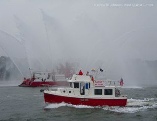 """The fireboat """"Three Forty Three"""" welcomes the finishers (photo by Johna)"""