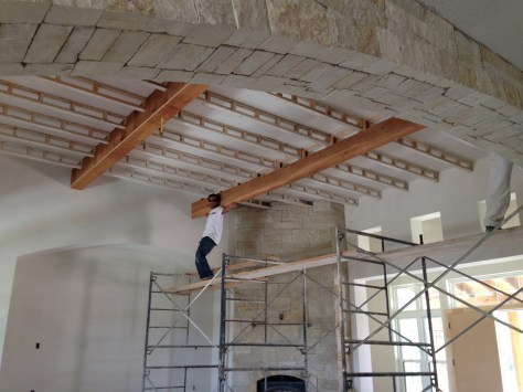 Laying down the foundation for the wooden beams in the living area.
