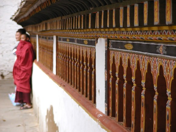 Temple in Bhutan with three monks in the background